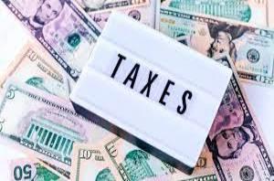 данъци